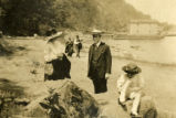 Unidentified people near beach or shore