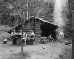 Hikers resting at a shelter cabin