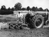 Wright.  Oliver Wright, Sr. with tractor.