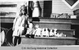 McCampbell.  Virginia McCampbell with dolls, ca. 1920.