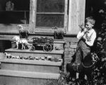 McCampbell. Shannon McCampbell with toy horses, ca. 1924.