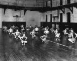 Employed Boys group in gym, 1920